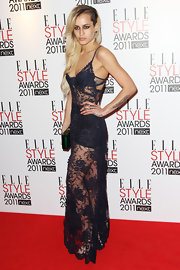 Alice Dellal smouldered in this sheer lace dress at the 2011 Elle Style Awards in London.