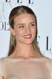 Rosie Huntington-Whiteley completed her look with a pair of dangling gemstone earrings by Irene Neuwirth.