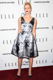 Georgia King looked like she stepped off the 'Mad Men' set in this silver floral cocktail dress with a bowed waist.