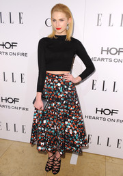 Claudia Lee completed her trendy ensemble with a pair of black strappy sandals by Jimmy Choo.