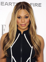 Laverne Cox wore her long hair down with a center part and subtle waves during the Elle Women in Television celebration.