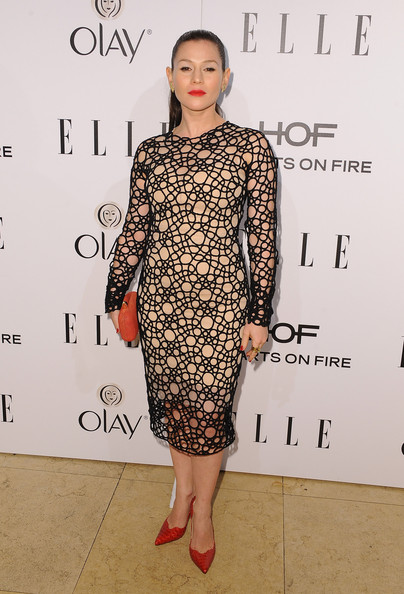 Yael Stone looked sassy and sophisticated in a patterned mesh-overlay dress during the Elle Women in Television celebration.