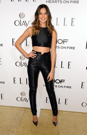 Odette Annable completed her outfit with a pair of black skinny pants by Paper London.