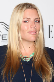 Busy Philipps added a pop of color to her navy dress with a jeweled collar necklace.