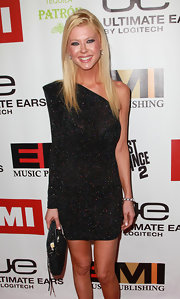 Tara Reid toughened up her red carpet look with a black leather First Small Classique bag.