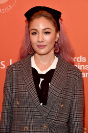 Constance Wu looked like an anime character wearing pink hair with a bowed headband at the Emily's List pre-Oscars brunch.
