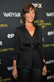 Carey Lowell look chic in a loose black blouse at the premiere of 'Everything or Nothing: The Untold Story of 007.'