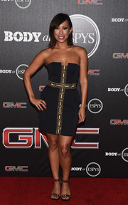 Cheryl Burke continued the black and gold theme with a pair of metal-embellished ankle-strap sandals.