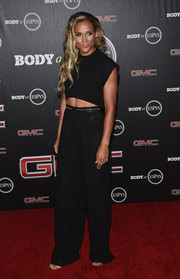 Lolo Jones teamed her top with matching black wide-leg pants.