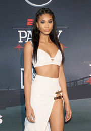 Chanel Iman turned heads in a white bra top and a high-slit skirt while attending ESPN The Party.