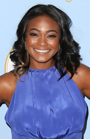 Tatyana Ali's shoulder-length curls showed off her hidden blond highlight.