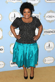Yvette Nicole Brown added some spice to her look with a gray leopard print knit top and teal full skirt.
