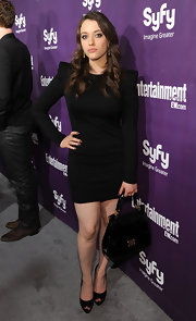 Kat Dennings showed off her long curls and black long-sleeve dress, while hitting Comic-Con.