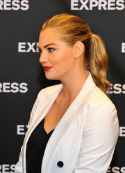 Kate Upton brushed her locks back into a ponytail for the Express Spring Fling event.