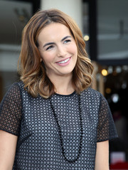 Camilla Belle accessorized her outfit with a glass beaded necklace for her appearance on 'Extra.'