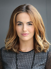 Camilla Belle styled her hair with bouncy curls for her appearance on 'Extra.'