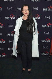 Marina Abramovic wore a black-and-white ensemble, topped off with a stylish wool coat, to the premiere of 'The East.'