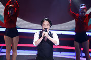Olly Murs performed at the Echo Award wearing a nice looking ensemble with a vest on top of a white button-down shirt.