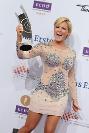 Helene Fischer chose a heavily beaded figure skating costume-inspired dress for the 2012 Echo Awards.