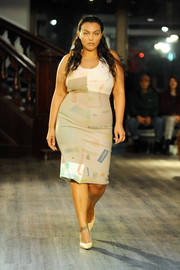 Paloma Elsesser walked the Eckhaus Latta fashion show wearing a neutral-toned dress that featured a subtle print.