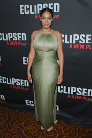 La La Anthony put her voluptuous figure on display in a seafoam green cutout gown by Maria Lucia Hohan at the Broadway opening of 'Eclipsed.'