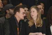 Bono and Chelsea Clinton front row at Edun - Mercedes-Benz Fashion Week Fall 2014 at Skylight Modern on February 9, 2014 in New York City.