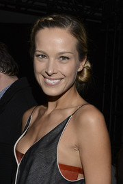 Petra Nemcova attended the Edun fashion show wearing a lovely chignon with a braided crown.