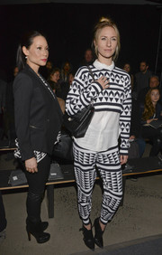 Mickey Sumner went for a fun, modern look with a black-and-white geometric-print blouse during the Edun fashion show.