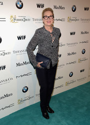 Meryl Streep kept it casual in a black-and-white Max Mara square-print blouse and a pair of slacks at the Women in Film pre-Oscar cocktail party.