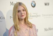 Elle Fanning went for boho flair with this center-parted 'do teamed with a ruffle dress during the Women in Film pre-Oscar cocktail party.