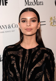 Emily Ratajkowski attended the Women in Film pre-Oscar cocktail party wearing a severe, slicked-down hairstyle.
