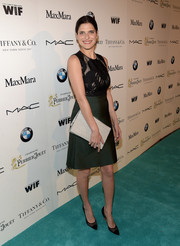 Lake Bell chose a Max Mara dress, featuring an embroidered, sheer-illusion bodice and a dark emerald skirt, for the Women in Film pre-Oscar cocktail party.