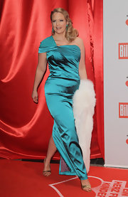 Barbara stepped out in gold strappy sandals. The heels kept all eyes on her satin turquoise gown.