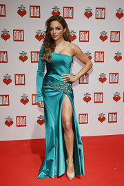 Estefania Kuester wore a single-sleeved aqua gown to the Ein Herz Fuer Kinder Charity Gala.