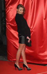 Sophia struck a sultry pose in black and gray suede color block pumps.