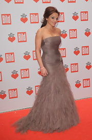 Estefania Kuester upped the glam factor in her strapless fishtail gown at a charity gala in Berlin.
