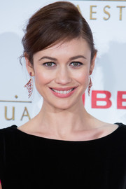 Olga Kurylenko went for an ultra-glam finish with a pair of pink tourmaline chandelier earrings by Shaun Leane.