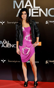 Actress Ciara Lago came out to an event in Madrid in a stunning Blumarine dress and a pair of black strappy heels, which worked well with her leather jacket.