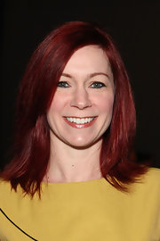 Carrie Preston's auburn tresses were bright and shiny at the Elene Cassis Spring 2012 fashion show. To try her look, blow-dry hair using a round brush to create sleekness and volume.
