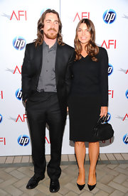 Sibi looks sophisticated at the AFI Awards in a black v-neck cardigan and knee-length skirt.