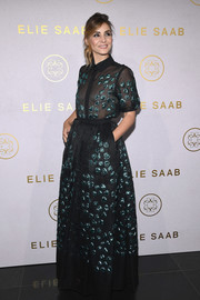 Clotilde Courau looked charming in an embellished maxi shirtdress at the Elie Saab Couture Fall 2017 show.