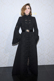 Clotilde Courau looked ultra glam in an embroidered black gown with bell sleeves at the Elie Saab Couture Spring 2018 show.