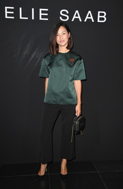 Nicole Warne kept it simple yet sophisticated in a short-sleeve green silk blouse at the Elie Saab Couture show.