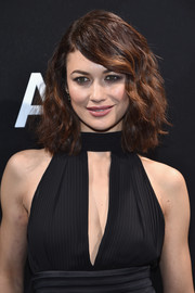 Olga Kurylenko looked fab with her high-volume waves at the Elie Saab Haute Couture show.