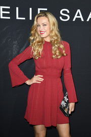 Petra Nemcova paired a black-and-white printed clutch with a red mini dress for the Elie Saab Couture show.