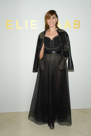 Clotilde Courau topped off her dress with a studded black leather jacket.