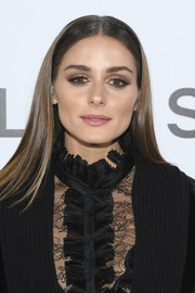 Olivia Palermo showed off glossy straight tresses at the Elie Saab Spring 2019 show.