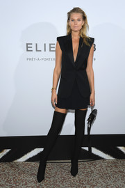 Toni Garrn gave her suit an edgy finish with a pair of black thigh-high boots.