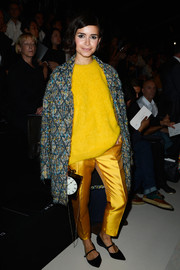 Miroslava Duma toned down her bright yellow sweater with a stylish tweed coat when she attended the Elie Saab fashion show.