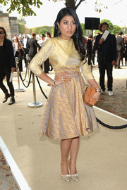 Sirivannavari Nariratana shimmered at the Elie Saab fashion show in a gold cocktail dress featuring an exotic pattern on the skirt.